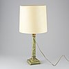 A 20th century empire style table lamp.