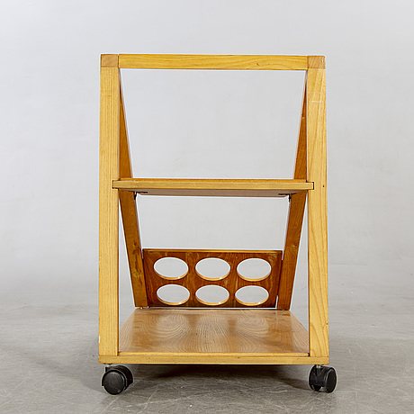 An italian oak trolley later part of the 20th century.