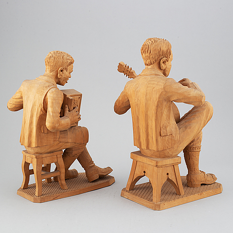 Two wooden sculptures attributed  to herman rosell, signed spanier.