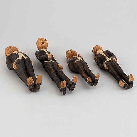 Four wooden sculptures by axel ericsson, signed and dated -29.