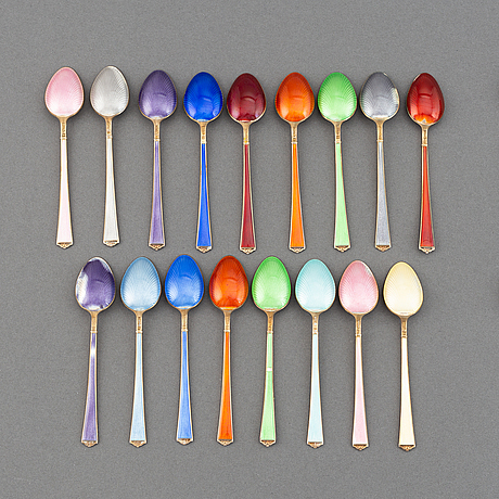 A mixed lot of 35 silver spoons, a tea strainer and two small dishes, parcel-gilt guilloché enamel, norway, 20th century.