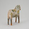 A painted swedish wooden horse from around year 1900.