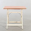 A reguitti folding table italy later part of the 20th century.
