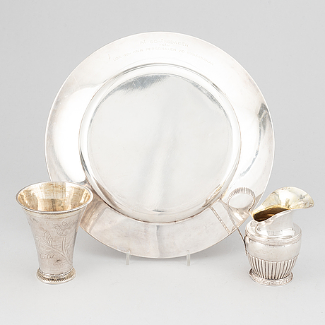 A silver creamer, beaker, and platter, sweden, 18-19th century.