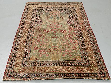 A rug, antique kerman laver, ca 205  x 125 cm.