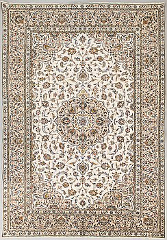 An Oriental carpet from Iran. Ca 340x238 cm.
