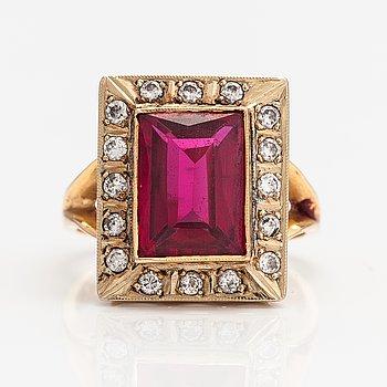 Ring, 18K guld, syntetisk rubin och diamanter ca 0.32 ct tot. Finland 1986.