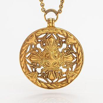 """A gilded bronze neckalce """"Åland pendant"""", model no. 67. Kalevala koru, Helsinki."""
