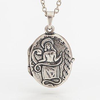 """Germund Paaer, A sterling silver necklace """"Pohjola's maiden/Madonna pendant"""". Kalevala Koru, Helsinki 2009."""