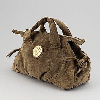 Gucci, a suede bag.