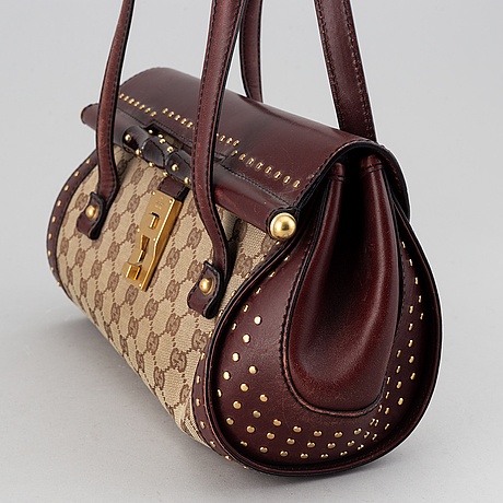 Gucci, a monogram canvas bag.