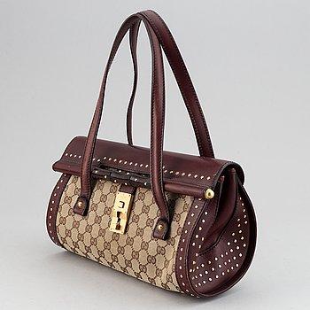 Gucci, a monogram canvas bag.