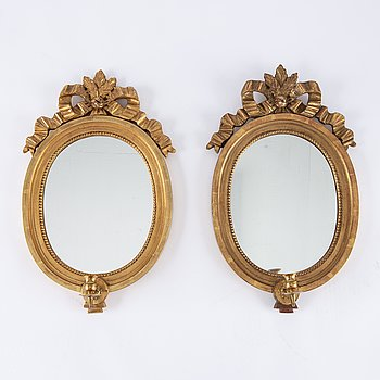 A pair of gilt Gustavian style mirror wall sconces, Stockholm, mid 20th Century.