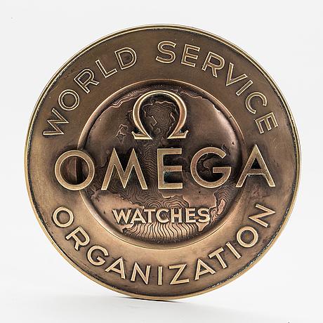 Omega, plaque.