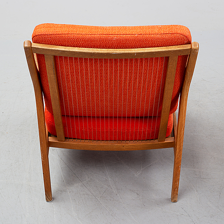 A pair of oak easy chairs, 1960's.