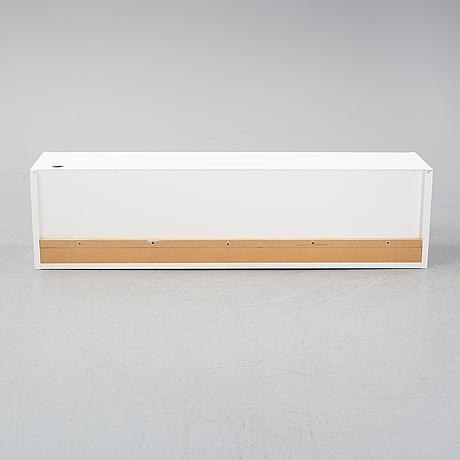 A 'funk' wall cabinet by per söderberg, designed th year 2000.