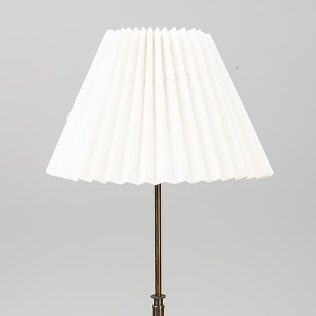 A brass floor light, mid 20th century.