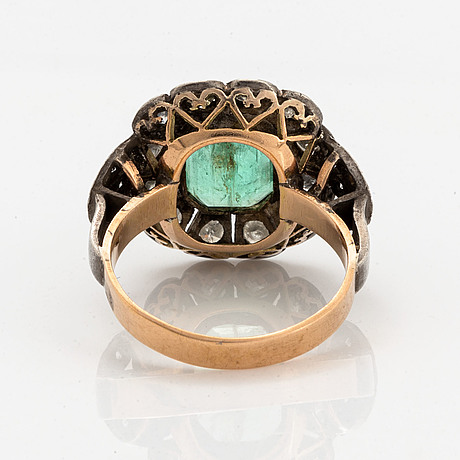 A 14k gold and silver ring set with an emerald.