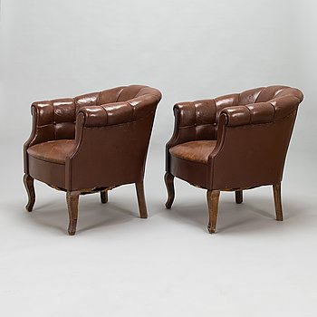 A pair of 1920's armchairs.