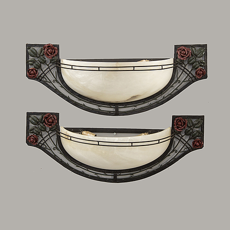 A pair of art nouveau style wall lamps later part of the 20th century.
