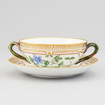Royal Copenhagen, A 'Flora Danica' porcelain soup cup with saucer.