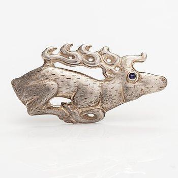 "Kaisaleena Mäkelä, A sterling silver brooch ""Elk"" with a synthetic spinelle. Kalevala Koru, Helsinki 1999."