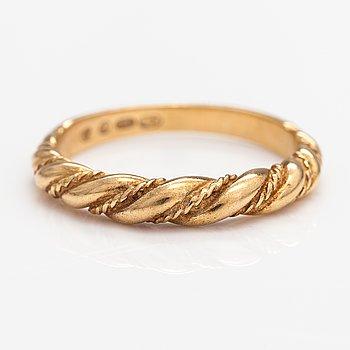 """An 18K gold ring """"Twined jewellery from Lampola in Halikko"""". Kalevala koru, Helsinki 1978."""
