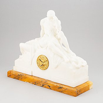 An alabaster mantle clock from the second half of the 19th-century.