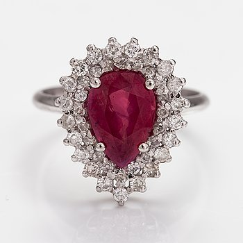 An 18K white gold ring with a ca. 3.01 ct ruby and briliant cut diamonds ca. 0.62 ct in total. With GIA certificate.