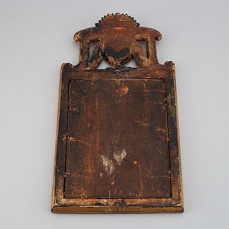 A swedish 18th century gilt wood mirror.