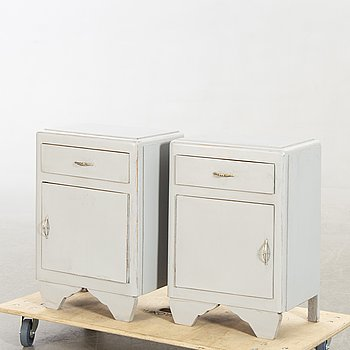 A pair of painted bedside tables first half of the 2oth century.