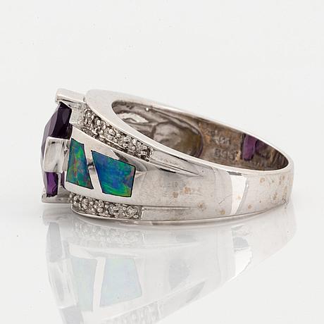 Checker-cut amethyst, opal and diamond ring.