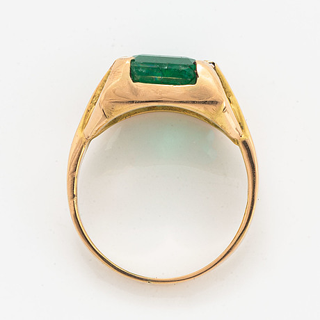 Emerald-cut emerald.