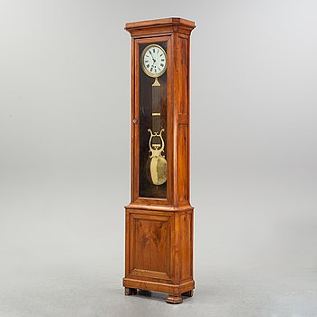 A walnut long case clock, from around the year 1900.