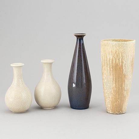Gunnar nylund, a set of four stoneware vases, rörstrand, sweden.
