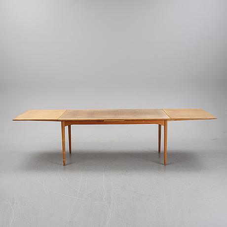 A 1960's teak dining table.