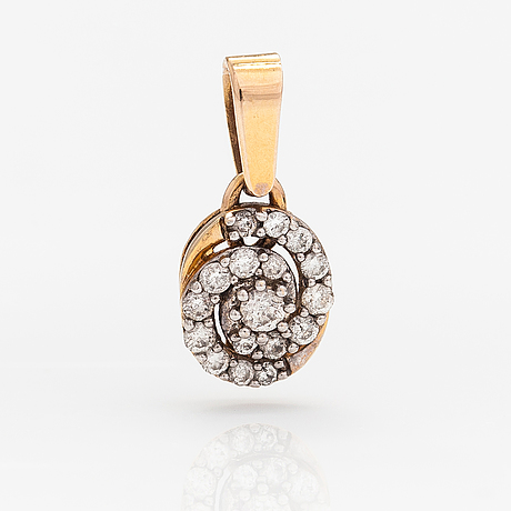A 14k gold pendant with diamonds ca. 0.20 ct in total.