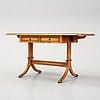 An english walnut table, mid 20th century.