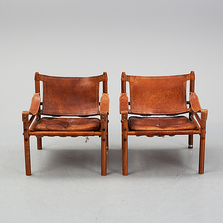 Arne norell, a pair of 'sirocco' rosewood armchairs, 1960's/70's.