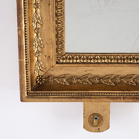 A pair of swedish empire mirror wall sconces, first half of the 19th century.