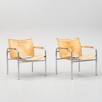 Tord Björklund, a pair of 'Klinte' tubular steel and leather armchairs, IKEA.