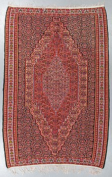 A rug, an old kilim, probably Senneh, ca 245-253,5 x 147-163 cm (as well as ca 1 cm flat weave at the ends).