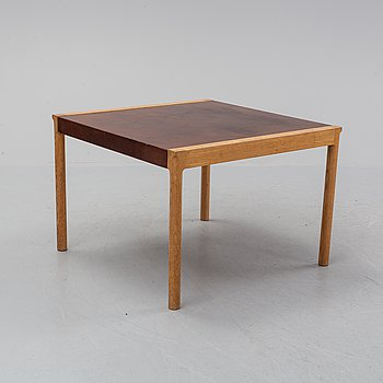 An oak and leather coffee table, mid 20th Century.