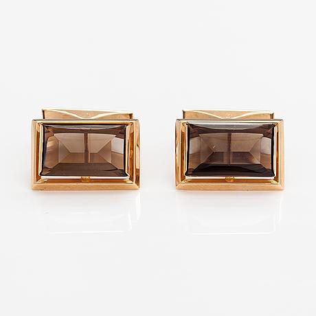 Apair of 14k gold cufflinks with smoaky quartzes. nummilan koru, turku 1975.