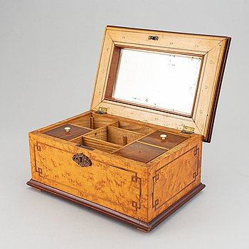 A wooden casket, dated 1874.