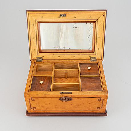 A wooden casket, dated 1874.