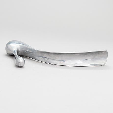 A metal shoe horn by manolo blahnik, 2000s.