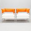 A pair of 21st century 'castor' armchairs for poltrona frau, italy.