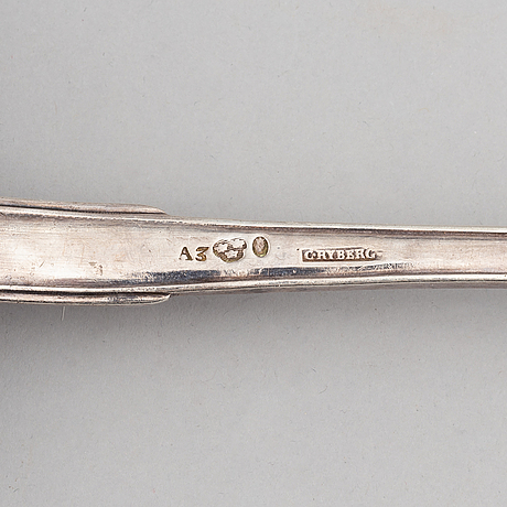 A silver soup ladle bearing the mark of carl magnus rydberg, stockholm 1807.