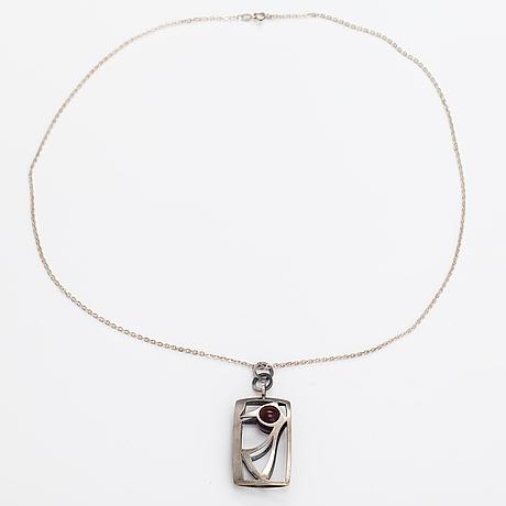 "Elis kauppi, a silver necklace ""woodpecker"" with a chalcedony. kupittaan kulta, turku 1966."